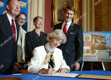 FRIST Interior Secretary Gale Norton signs a decree on Capitol Hill to designate Sun Studio of Memphis, Tenn., a National Historic Landmark. Joining her from left are, Sen. Lamar Alexander, R-Tenn., Sun Studio General Manager John Schorr, City of Memphis's intergovernmental affairs office administrator Dottie Jones, Norton, and Sen. Majority Leader Bill Frist of Tenn. Sun Records founder Sam Phillips, who gave Elvis Presley his first record contract after hearing the young man sing for his mother and was involved in the early careers of other music legends, died Wednesday, July 30, 2003, of respiratory failure at St. Francis Hospital in Memphis, his son Knox Phillips said. He was 80