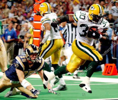 GREEN COADY FERGUSON Green Bay Packers' Ahman Green (30) crosses the goal line to score in front of St. Louis Rams' Rich Coady during the second quarter, at the Edward Jones Dome in St. Louis. Green Bay's Robert Ferguson reacts in the background