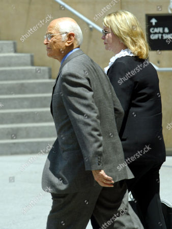 LEAR DAVIS Producer Norman Lear, left, is joined by wife Lyn Davis as they arrive at the Cathedral of Our Lady of Angels in Los Angeles, for a public memorial service for actor Gregory Peck. Peck died at age 87 last Thursday
