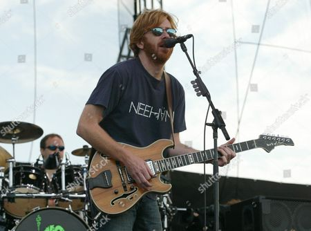 """ANASTASIO FISHMAN Phish guitarist Trey Anastasio, right, and drummer Jon Fishman, rear, perform, on the first of their two-day """"It"""" festival at the former Loring Air Force Base in Limestone, Maine"""