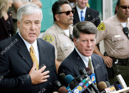 Stock Photo of BROWER BARNETT Ronald Brower, left, attorney for former Inglewood, Calif., police officer Bijan Darvish, and John D. Barnett, attorney for former officer Jeremy Morse, talk with reporters after verdicts were announced in the trial of the officers in connection with the videotaped arrest of a handcuffed teenager, outside a Los Angeles court building