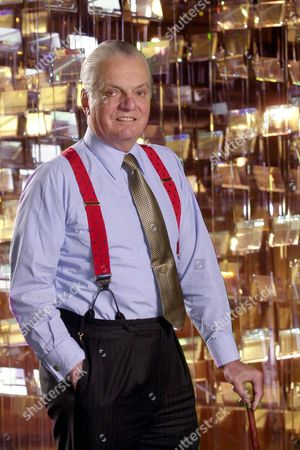 """HOUGHTON Corning Inc. chief executive James Houghton poses in front of a glass sculpture at Corning Inc. in Corning, N.Y., . Houghton whose great-great-grandfather pioneered the """"scientific glass company"""" is the unsentimental patriarch overseeing its painful recovery from the telecommunications crash of 2001"""
