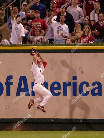 EDMONDS St. Louis Cardinals' Jim Edmonds makes a leaping catch on a ball hit by Cincinnati Reds' Jason Larue in the fifth inning, in St. Louis