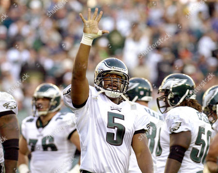 Stock Picture of MCNABB Philadelphia Eagles quarterback Donovan McNabb waves to the crowd after fullback Jon Ritchie scored the Eagles' first touchdown during the first quarter against the Washington Redskins, in Philadelphia. The Eagles won 27-25