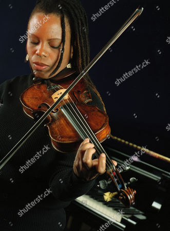 "CARTER Jazz violinist Regina Carter plays the violin at the Sweet Rhythm Jazz Club in New York, . For her new album, ""Paganini: After a Dream,"" Carter was granted permission to perform on Paganini's world-famous violin so revered it sits under lock and key in Italy, played only by a few privileged artists. The recording, which took place in Genoa, Italy, is the culmination of her odyssey involving Paganini's violin, known in classical music circlesas ""the cannon"" because of its loud, booming sound"