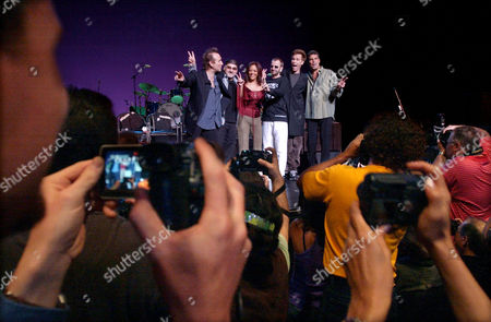 """Ringo Starr, third from right, poses with members of """"Ringo Starr and his 8th All Star Band"""" featuring guitarist Colin Hay, far left, keyboardist Paul Carrack, second from left, drummer Sheila E, third from left, bassist John Waite, second from right, and saxophonist Mark Rivera, far right, during a press conference in New York, . The group will play perform 35 concerts in a nationwide through September"""