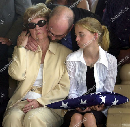 BENTLEY The mother of former soldier Jason Bentley, Gail Bentley, left, is consoled by Brian Bentley, center, as Sarah Bentley, right, daughter of Jason, looks, during a funeral service at the Dallas Fort Worth National cemetery in Dallas. Jason Bentley was one of three Texans killed in a terrorist attack last week in Saudi Arabia