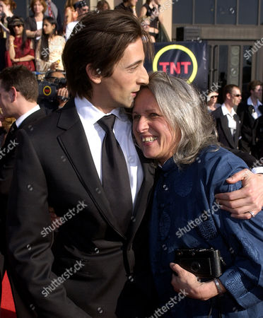 "Actor Adrien Brody, left, hugs his mother, photographer Sylvia Plachy, as he arrives for the 9th annual Screen Actors Guild awards in Los Angeles, . Brody is nominated for his work in the film ""The Pianist"