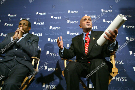 Stock Image of H. Carl McCall, left, Chairman of the NYSE Compensation Committee and Dick Grasso, right, Chairman and CEO of NYSE, attend a press conference in New York, where they discussed a letter the NYSE sent the Securities and Exchange Commission regarding Dick Grasso's compensation package