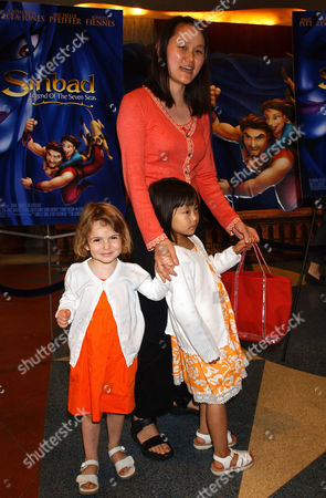 """ALLEN Soon-Yi Allen, wife of Woody Allen, arrives with her children, Bechet, left, and Manzie Tio, for the screening of """"Sinbad, Legend of the Seven Seas"""", in New York"""