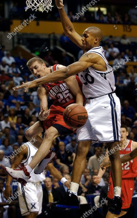 WEST Maryland guard Steve Blake (25) passes the ball away as his path is cut off by Xavier forward David West (30) in the first half at the NCAA South Regional basketball tournament on in Nashville, Tenn