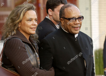 JONES Quincy Jones, right, arrives to the opening of the first Stella McCartney store in Los Angeles with his daughter Jolie, in West Hollywood, Calif