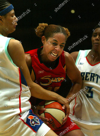 WHITMORE SALES ROBINSON Connecticut Sun's Nykesha Sales, center, fights for the ball with New York Liberty's Tamika Whitmore, left, and Crystal Robinson, right, during second half action at Madison Square Garden in New York, . Connecticut won the game 84-71