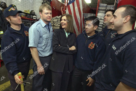 """Journalist Anne Nelson poses for a photo during a visit to New York Fire Dept. Engine 44 in New York, . Nelson wrote """"The Guys,"""" an off-Broadway play about a journalist who helps a fire captain write eulogies for colleagues who died in the Sept. 11 World Trade Center attack. The play has become a movie, starring Sigourney Weaver and Anthony LaPaglia. Firefighters, from left, are: Chris Larney, Lt. Ed Ryan, Globert Trayvilla, Rob Coppola and Eric Lopez"""