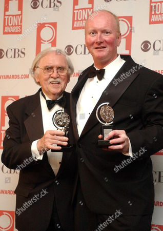 "Thomas Meehan, left, and Marc O'Donnell pose with their Tony award for Best book of a Musical for ""Hairspray"" during the 57th Annual Tony Awards, at New York's Radio City Music Hall"