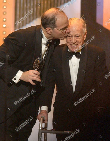Jed Bernstein, left, kisses producer Sy Fever while presenting him with the Lifetime Achievement Award during the 57th Annual Tony Awards, at New York's Radio City Music Hall