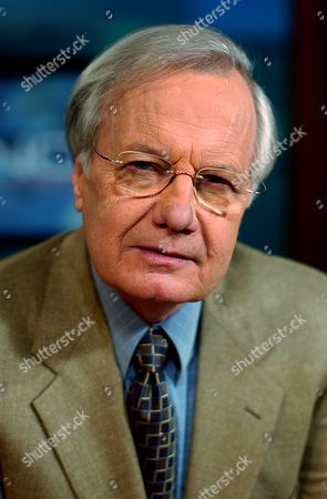 """MOYER Bill Moyers poses on the set of his PBS newsmagazine """"Now with Bill Moyers"""" in New York, . Moyers will talk about the state of public health around the world with his guest, Microsoft billionaire and philanthropist Bill Gates, in a show that airs Friday, May 9"""