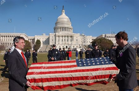 SCHULMAN BEER Jim Schulman, left, and Michael Beer, both of Washington, D.C., hold a mock coffin draped with an American flag near the U.S. Capitol during a protest opposing a possible war with Iraq. Several hundred people in opposition to the impending war gathered on the National Mall near the Capitol as part of a protest sponsored by the anti-war group Iraq Pledge of Resistance. The flag-draped coffin signifies the possible death of American military personnel during the war