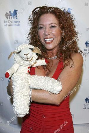 Mallory Lewis and Lamb Chop