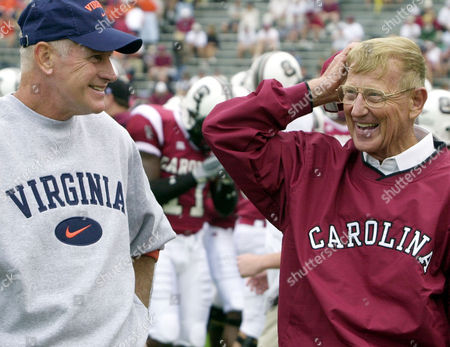 GROH,HOLTZ Virginia football coach Al Groh, left, and Lou Holtz coach of the University of South Carolina chat at midfield prior to their game, at Wiliams-Brice Stadium in Columbia, S.C., South Carolins upset 15th ranked Virginia 31-7