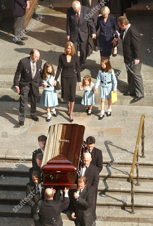 BLOOM Melanie Bloom, center, hold hands with her children, as she follows behind the casket of her husband and their father David Bloom, a NBC reporter, after funeral services in New York, . Bloom, 39, the weekend anchor of NBC's ''Today'' and a former White House correspondent, died of an apparent blood clot April 6 while embedded with a military unit in Iraq