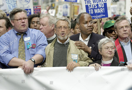 Stock Photo of DUANE SCHEIDER PERKINS Democratic New York state Sen. Tom Duane, left, actor Roy Scheider, second left, and New York City Council member Bill Perkins, third left, join an anti-war march in New York, . Tens of thousands of anti-war demonstrators, spanning almost a dozen blocks, marched down Broadway on Saturday in a fresh cross-country protest drive against intensified war on Iraq