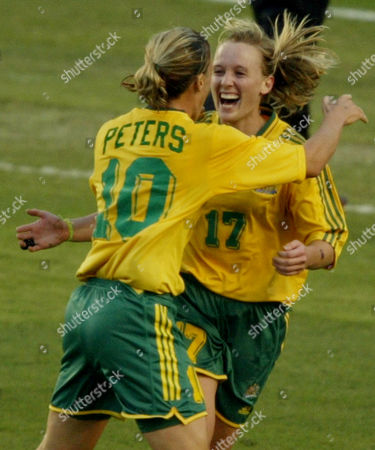 Stock Image of Australia's Danielle Karp (17) and Joanne Peters (10) celebrate after their teammate Kelly Golebiowski (not seen) scored a goal in the first half against Russia during their first round match at the 2003 Women's World Cup in Carson, Calif