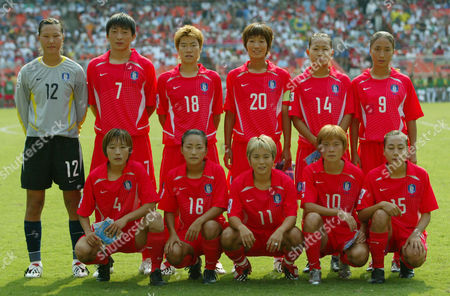 YOO Members of the South Korean soccer team pose prior to their first round World Cup soccer match against Brazil, at RFK Stadium in Washington. Back row, from left are, Jung Mi Kim, Eun Sun Park, Yoo Mi Kim, Young Sil Yoo, Ji Eun Han and Ju Hee Song. Front row, from left are, Yu Jin Kim, Sun Nam Shin, Ji Eun Lee, Jin nHee Kim and Kyul Nam Shin