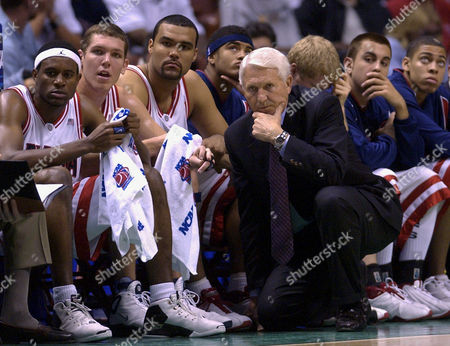 OLSON Arizona head coach Lute Olson and the Arizona bench look concerned as they watch the action late in the first half of their NCAA West Regional final game against Kansas, in Anaheim, Calif