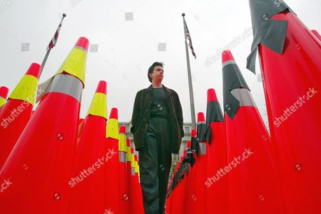 BELL Thomas Bell, who lost his brother in a work zone accident, is seen as he walks through safety cones during the fourth annual Work Zone Awareness Week held in Washington . A field of orange work zone cones draped with black memorial ribbons to commemorate motorists who died, and fluorescent yellow-green ribbons commemorate workers who were killed. Eighty percent of the 1,079 people killed in construction-zone crashes in 2001 were drivers or passengers, the American Association of State Highway and Transportation Officials said Tuesday