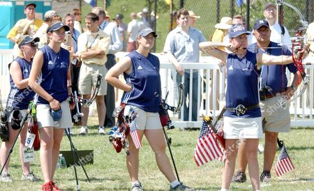 United States archer Aya La Brie, right, takes aim at the target as coach Robert Romero, behind, and teammates, from left, Christie Bisco, Mary Zorn, and Amber Dawson look on during the Men's Compound finals at the 42nd World Archery Championship, in New York. The U.S. team defeated the French team, 248 points to 239 points