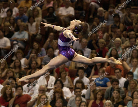 GOMEZ Bronze medal winner Elena Gomez performs a floor exercise in the women's individual event finals at the 2003 World Gymnastics Championships in Anaheim, Calif