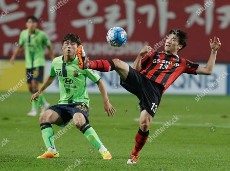 Go Yo-han, Jang Yun-ho Go Yo-han, right, of South Korea's FC Seoul fights for the ball against Jang Yun-ho of South Korea's Jeonbuk Hyundai Motors during the second leg of AFC Champions League semifinal soccer match at Seoul World Cup Stadium in Seoul