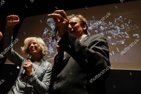 Italian Space Agency President Roberto Battiston and Italian Education Minister Stefania Giannini celebrate after they received a message announcing the landing of the Schiaparelli space module during an event organized by Italy's Space Agency, on the occasion of the insertion of the Trace Gas Orbiter into orbit around Mars, and the landing of the Schiaparelli module on the surface of the planet, in Rome