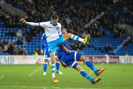 Marouane Chamakh of Cardiff City clatters into David Jones of Sheffield Wednesday during the EFL Sky Bet Championship match between Cardiff City and Sheffield Wednesday at the Cardiff City Stadium, Cardiff
