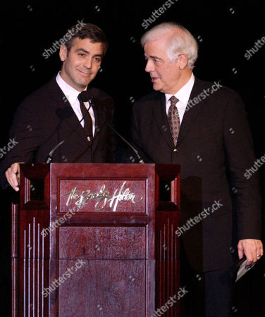 "CLOONEY CLOONEY Actor George Clooney, left, and his father, broadcaster Nick Clooney, address the audience at ""An Evening to Remember Rosemary Clooney,"" in Beverly Hills, Calif"