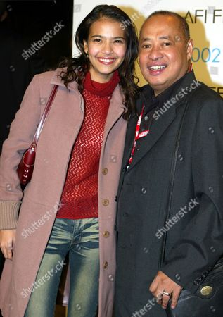 "Stock Image of DE ROSSI PORTES Philippines actress Alessandra De Rossi and director Gil Portes, right, whose movie ""Small Voices,"" is an official selection at the American Film Institute AFI Fest 2002, arrive, at the premiere of Denzel Washington's film ""Antwone Fisher"" screening night at the Cinerama Dome in the Hollywood area of Los Angeles"