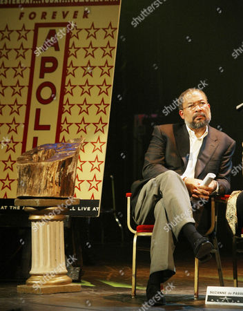 """PARSONS AOL/Time Warner CEO Dick Parsons, sitting next to the """"Tree of Life"""", left, listens before being introduced at a news conference, at Harlem's Apollo Theater in New York. Parsons helped announce a new partnership with de Passe Entertainment and The Heritage Network to produce the famous """"Showtime at the Apollo"""" variety show at the Apollo Theater for the 2002/2003 season"""