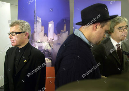 LIBESKIND VINOLY Berlin-based architect Daniel Libeskind, left, stands in front of a display of his model picked as a finalist in the selection of a design to rebuild the World Trade Center, in New York. Libeskind, who designed Berlin's Jewish Museum, proposed starkly geometrical buildings clustered around the foundations of the fallen towers and topped by a 1,776-foot spire. Rafael Vinoly, far right, whose New York based firm designed the second finalist, talks with reporters
