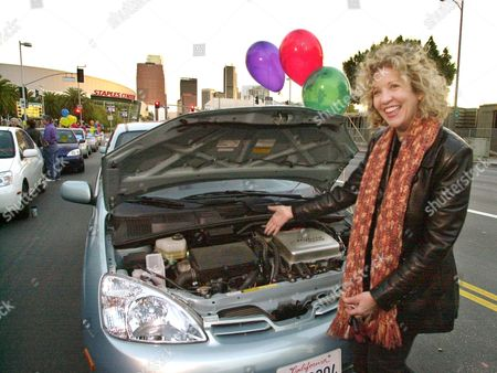 ALLEN Actress Nancy Allen displays the engine of her car during a rally of hybrid car owners demonstarting outside the Greater Los Angeles Auto Show . The Union of Concerned Scientists issued a report Friday, Jan. 3, 2003, calling on auto manufacturers to fully embrace hybrid technology as a means of boosting fuel efficiency and cutting pollution