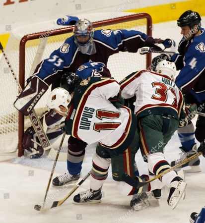 WALZ Minnesota Wild's Pascal Dupuis (11) can't get his stick on a rolling puck in front of Colorado Avalanche goalie Patrick Roy (33) in the first period, in St. Paul, Minn. The Avalanche's Valclav Nedorost (22) and Rob Blake (4) defend as the Wild's Wes Walz (37) looks on