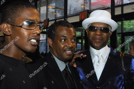 "THOMAS BELL Original members of the singing group Kool & The Gang, from right, Dennis ""DT"" Thomas and Robert ""Kool"" Bell, along with newer member Hakim ""Prince Hakim"" Bell, pose for a photograph at the National Black Sports and Entertainment Hall of Fame induction ceremony in New York, . Kool & The Gang were among the events' 2002 inductees"