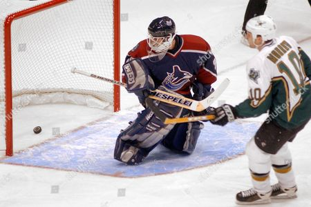 CLOUTIER MORROW Vancouver Canucks goalie Dan Cloutier watches the puck go into the net on a penalty shot by Dallas Stars' Brendan Morrow (10) during the first period Wednesday night, in Dallas. Cloutier gave up three goals in the period
