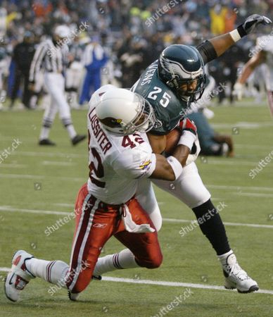 LEVENS LASSITER Philadelphia Eagles running back Dorsey Levens (25) carries Arizona Cardinals defender Kwamie Lassiter (42) into the end zone for a second-quarter touchdown in Philadelphia