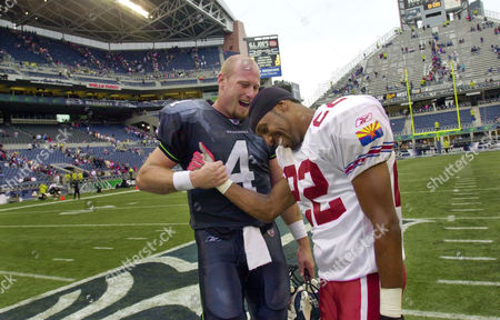 DILFER STARKS Seattle Seahawks quarterback Trent Dilfer greets Arizona Cardinals cornerback Duane Starks following their game, in the team's new stadium in Seattle. Arizona won, 24-13