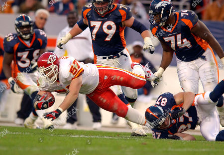 SALAAM Kansas City Chiefs linebacker Mike Maslowski (57) is tripped up by Denver Broncos wide receiver Ed McCaffrey (87) after Maslowski intercepted a pass intended for McCaffrey during the third quarter in Denver on . Also pictured for the Broncos are Mike Anderson (38), Steve Herndon (79) and Ephraim Salaam (74