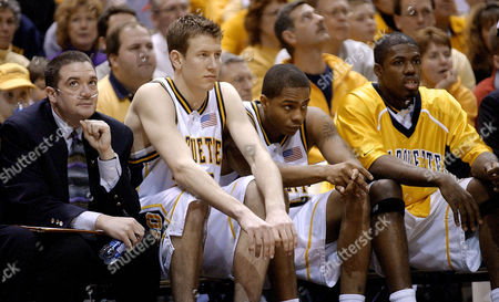SCHWAB Marquette assistant coach Trey Schwab watches his team from the bench with players, from left to right, Steve Novak, Joe Chapman and Terry Sanders in the second half against Wake Forest, in Milwaukee. Schwab has a rare and incurable disease called idiopathic pulmonary fibrosis and is awaiting a lung tranplant