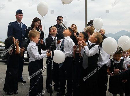 Stock Photo of GODFREY VICTIM'S NAME TO GLENN, CORRECTS SPELLING OF SENATOR'S NAME TO TED ** Glenn Godfrey's grandchildren and family release balloons after reciting the Lord's Prayer at the end of a memorial service for the former public safety commissioner and Alaska State Trooper in Anchorage, Alaska, . Godfrey was shot to death in his Eagle River, Alaska, home in early August by Karen Brand who committed suicide and wounded Godreys's wife Patti. Over 2,500 people including Sen. Ted Stevens, R-Alaska, Gov. Tony Knowles and other dignitaries attended the service