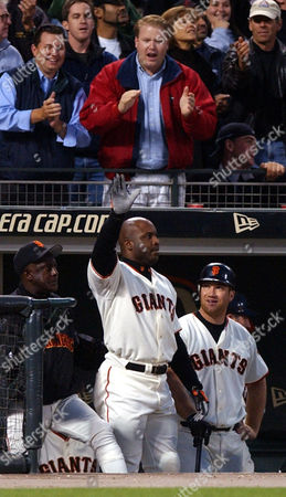 BONDS San Francisco Giants' Barry Bonds waves to fans from the dugout after hitting his 599th career home run off Chicago Cubs' Steve Smyth in the third inning, at Pacific Bell Park in San Francisco