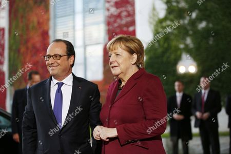 German Chancellor Angela Merkel welcomes the French president Francois Hollande prior to a meeting in the Normandy format with Russian President Vladimir Putin and Ukrainian President Petro Poroschenko at the chancellery